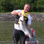 Jeremy with striper, Melton Hill Dam, 2005
